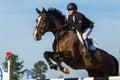 Rider woman horse jumping Arkivbild