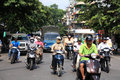 Riders ride motorbikes on busy road in Hanoi Royalty Free Stock Images