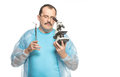 The ridiculous fat surgeon with a cigarette and a microscope Royalty Free Stock Photo