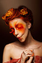 Ridiculous woman flowers having fun theatrical style Stock Images