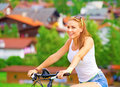 Riding on bicycle in alpine mountains Royalty Free Stock Images