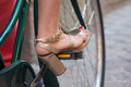 Riding a bicycle with high heels Royalty Free Stock Photo