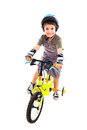 Riding bike happy cute boy his being Royalty Free Stock Images