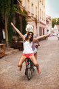Riding on bike happy young women bicycle with her boyfriend Stock Image