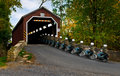 Riding Through the Covered Bridge Stock Photo