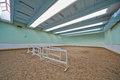Riding hall with sandy covering indoor Stock Photo