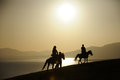 Riding horse at sunrise chinese people Royalty Free Stock Photo