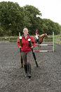 Riding instructor building a new fence for her pupil Royalty Free Stock Photo