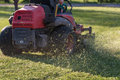 Riding Lawn Equipment with operator Royalty Free Stock Photo