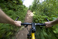 Riding mountain bike fast on a trail young man his down in montana Stock Image