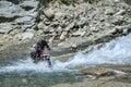 Riding through mountain river wade on bike in indian himalaya Stock Photo