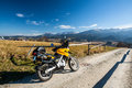 Riding mountains on motorbike off road gravel road traveling Royalty Free Stock Photo