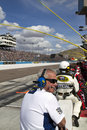 Riding the nascar pit road wall crew members and officials straddle at sprint cup race at phoenix international raceway Stock Image