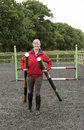 Riding school instructor with fence poles Royalty Free Stock Photo
