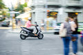 Riding a scooter panning shot of man in italy Royalty Free Stock Photo