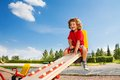 Riding seesaw happy little three years old child with big smile and happy face Royalty Free Stock Image