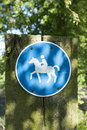 Riding trail traffic sign in a forest Royalty Free Stock Photo