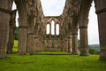 Rievaulx abbey scenic view of ruins of under cloudscape north yorkshire moors national park england Royalty Free Stock Images