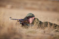 Rifle shooting a young cadet laying in the dry grass target Royalty Free Stock Photo