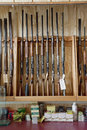 Rifles on display in gun shop Stock Photos