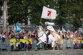 Riga latvia august member of the devils horsemen stunt te team riding white horse and holding spear during festival on in Royalty Free Stock Image