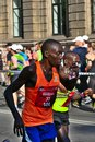 stock image of  Riga, Latvia - May 19 2019: Closeup from Elite male runner Julius taking sip from water