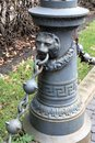 Riga, Latvia, November 2019. Closeup of a road post with a chain and a muzzle of a lion. Royalty Free Stock Photo