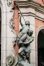 Riga, Latvia. Statues On Facade Of Old Cinema Building In Elizabetes