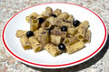 Rigatoni with olive Stock Photography