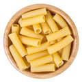 Rigatoni pasta in wooden bowl isolated on white Royalty Free Stock Photo