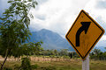 Right bend a sign indicating a in the road against a mountain landscape in northern thailand Stock Images