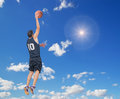 Right dunk in the sky basketball player doing a Stock Photo