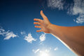 Right hand touching the blue sky with clouds arm Stock Photos