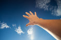 Right hand touching the sky as call for assistance blue Stock Images