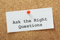 The right questions ask typed on a piece of graph paper and pinned to a cork notice boards this is essential to make an impression Stock Images