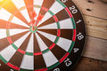 Right on target concept using dart in the bullseye on dartboard Royalty Free Stock Photo