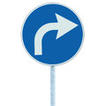 Right turn ahead sign, blue round isolated roadside traffic signage, white arrow icon and frame roadsign, grey pole post Royalty Free Stock Photo