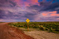 Right turn sign on dirt road Stock Photo