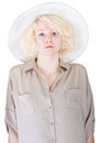 Rigid lady in brown single stoic european female with safari cap and shirt Royalty Free Stock Photos