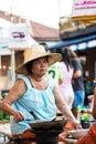 Rim yom night market sukhothai thailand may unidentified mature woman is selling thai traditional snack on may at sukhothai Royalty Free Stock Photo