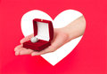 Ring in a box woman hands against red heart Royalty Free Stock Photography