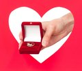 Ring in a box woman hands against red heart Royalty Free Stock Image