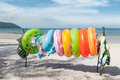 Ring buoys on the beach many hanging a stick in a shadow of quan lan island vietnam Stock Image