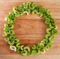 Ring of celery pieces circle chopped on wood chopping board background Stock Photo