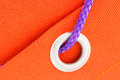 Ring and cord on orange fabric macro metal blue Royalty Free Stock Photos