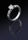 Ring with diamonds on dark background Stock Photos