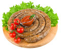 Ring of fried sausage from the pork stuffing isolated on a white background Stock Photos
