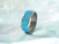 Ring with glitters polymer clay and on soft blue background Stock Image