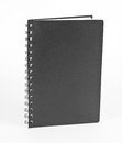 Ring notebook with black cover on white background. Royalty Free Stock Photo