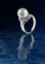 Ring with pearl on water Royalty Free Stock Image